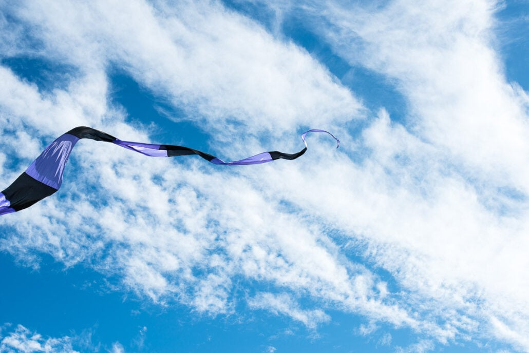 Kite flying on the Texas coast, Kite Tails #0254, photograph by Jeff Kauffman
