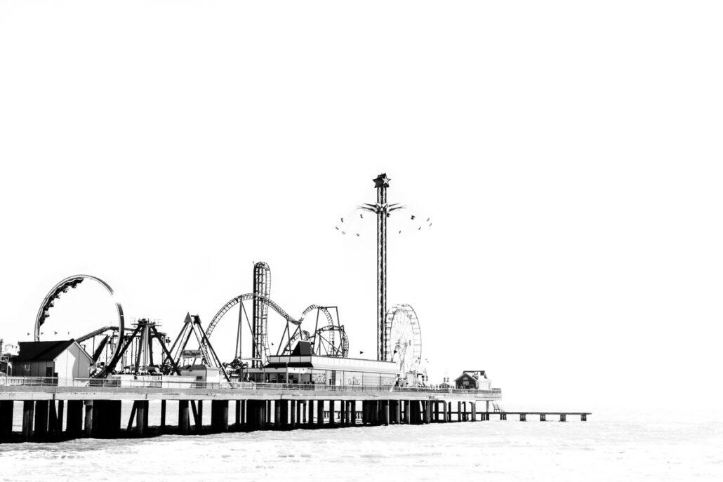 Galveston Pleasure Pier in B&W #131129A0312. Photograph by Jeff Kauffman.