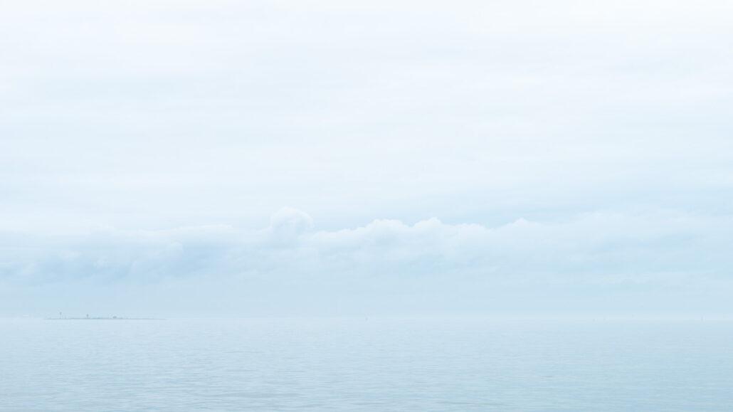Wide Open Space, Fog Bank #0251. haze rain and fog envelop Galveston Bay. Photograph by Jeff Kauffman.